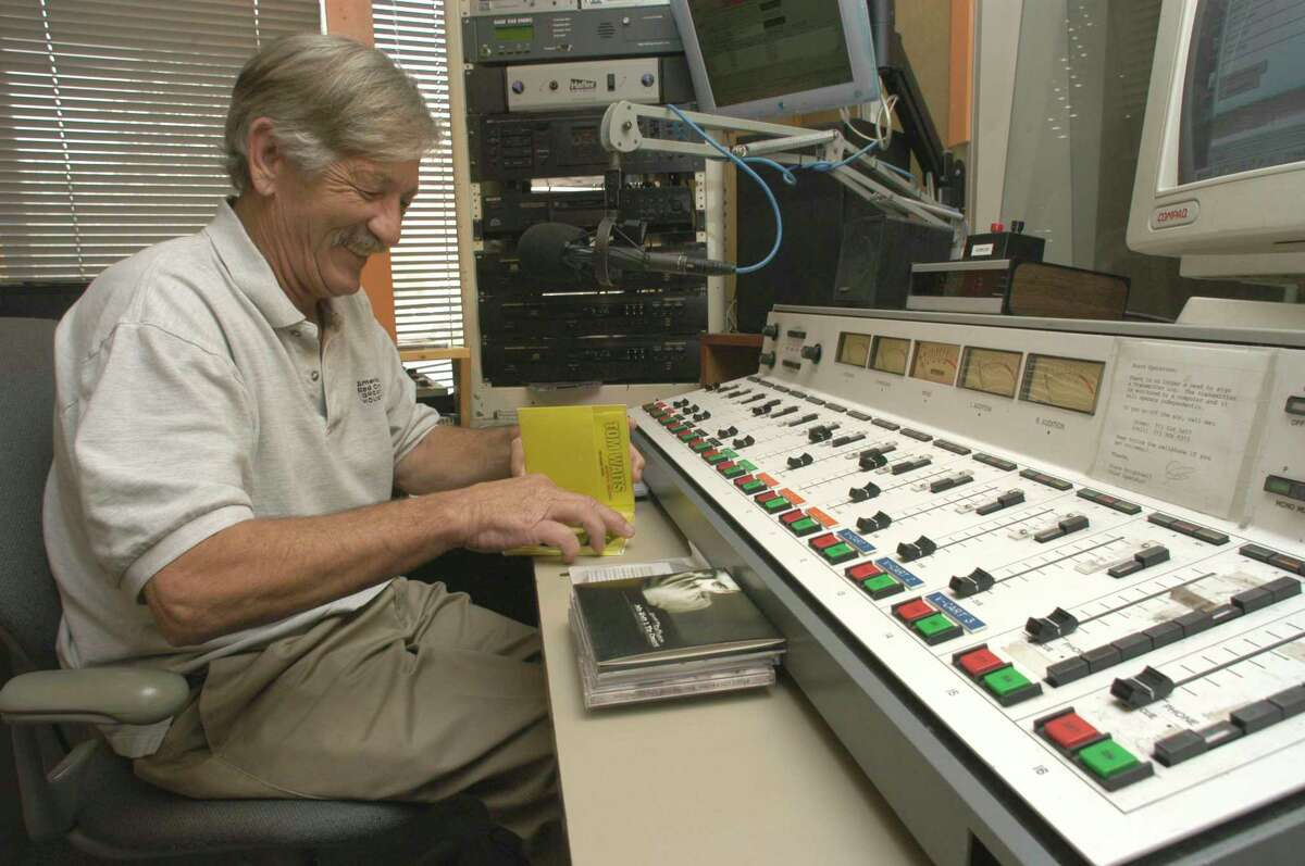 """For decades, DJ Larry Winters captivated listeners of """"Spare Change"""" from KPFT on Lovett in Houston. He chuckles in 2004 before tossing a Tom Waits song into the mix."""
