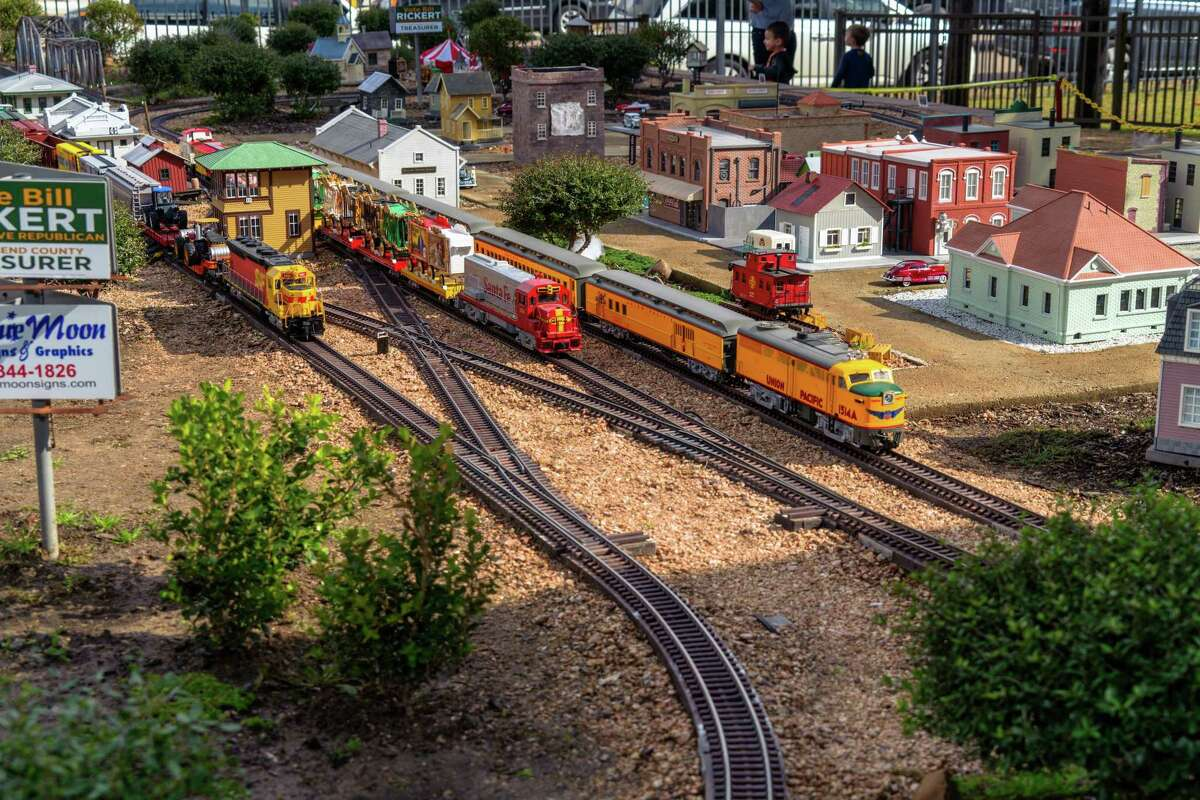 The Garden Railroad is a G Gauge model railroad depiction of Rosenberg and Richmond in the 1950s with plants, a water feature representing the Brazos river, replica automobiles, animals and people and various historic buildings.