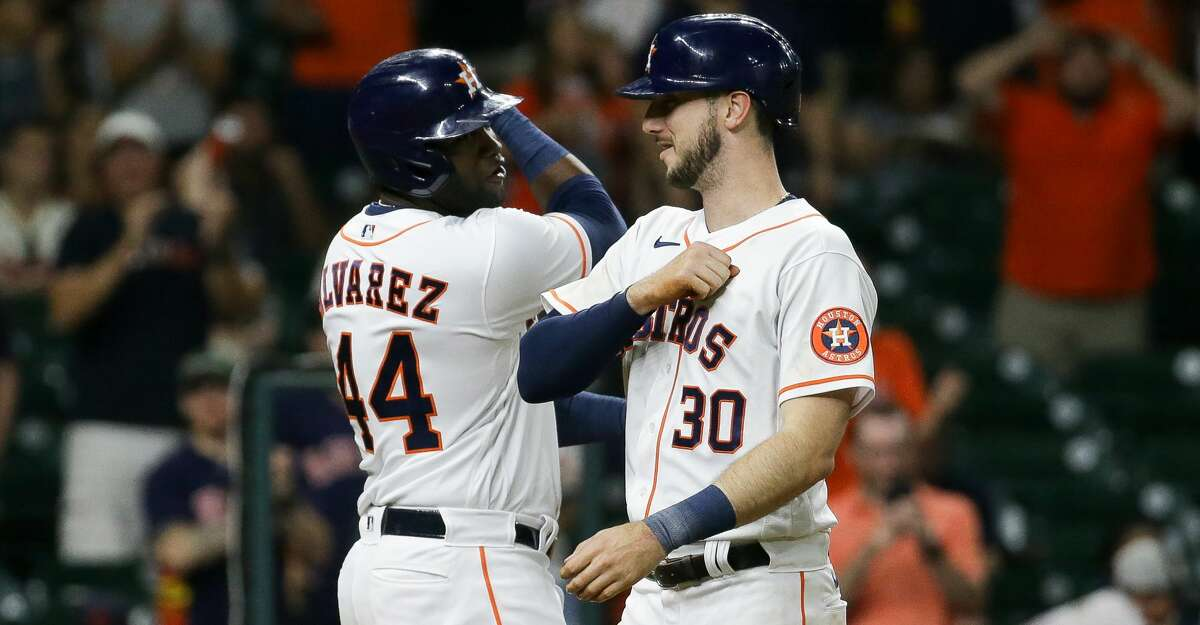 Houston Astros right fielder Kyle Tucker (30) celebrates with designated hitter Yordan Alvarez (44) after hitting a two-RBI home run against Cleveland during the fifth inning of an MLB game at Minute Maid Park on Tuesday, July 20, 2021, in Houston.
