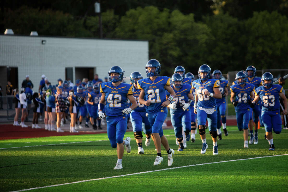 Midland players take to the field before their game against Mt. Pleasant Friday, Sept. 24, 2021 at Midland Community Stadium. (Katy Kildee/kkildee@mdn.net)