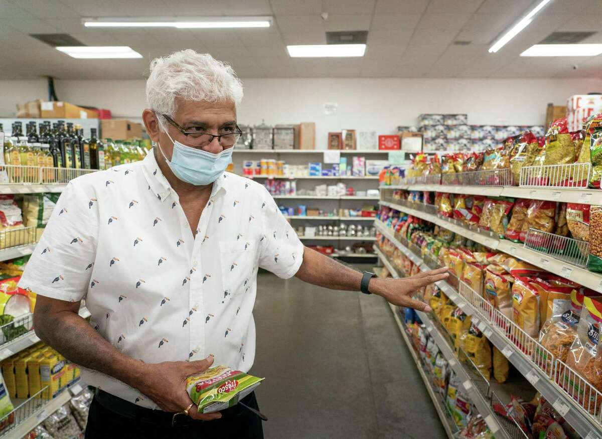 Ramesh Chittur has owned Asian Market since 2009, which caters to the Indian and Pakistani community in the area with specialties like basmati rice, spices, tea and other specialty foods. Photographed on Thursday, Sept. 23, 2021, in Sugar Land. Chittur gets hundreds of customers each day and says he can see the growth of the Indian and Pakistani community in the many new faces of customers shopping in his store.