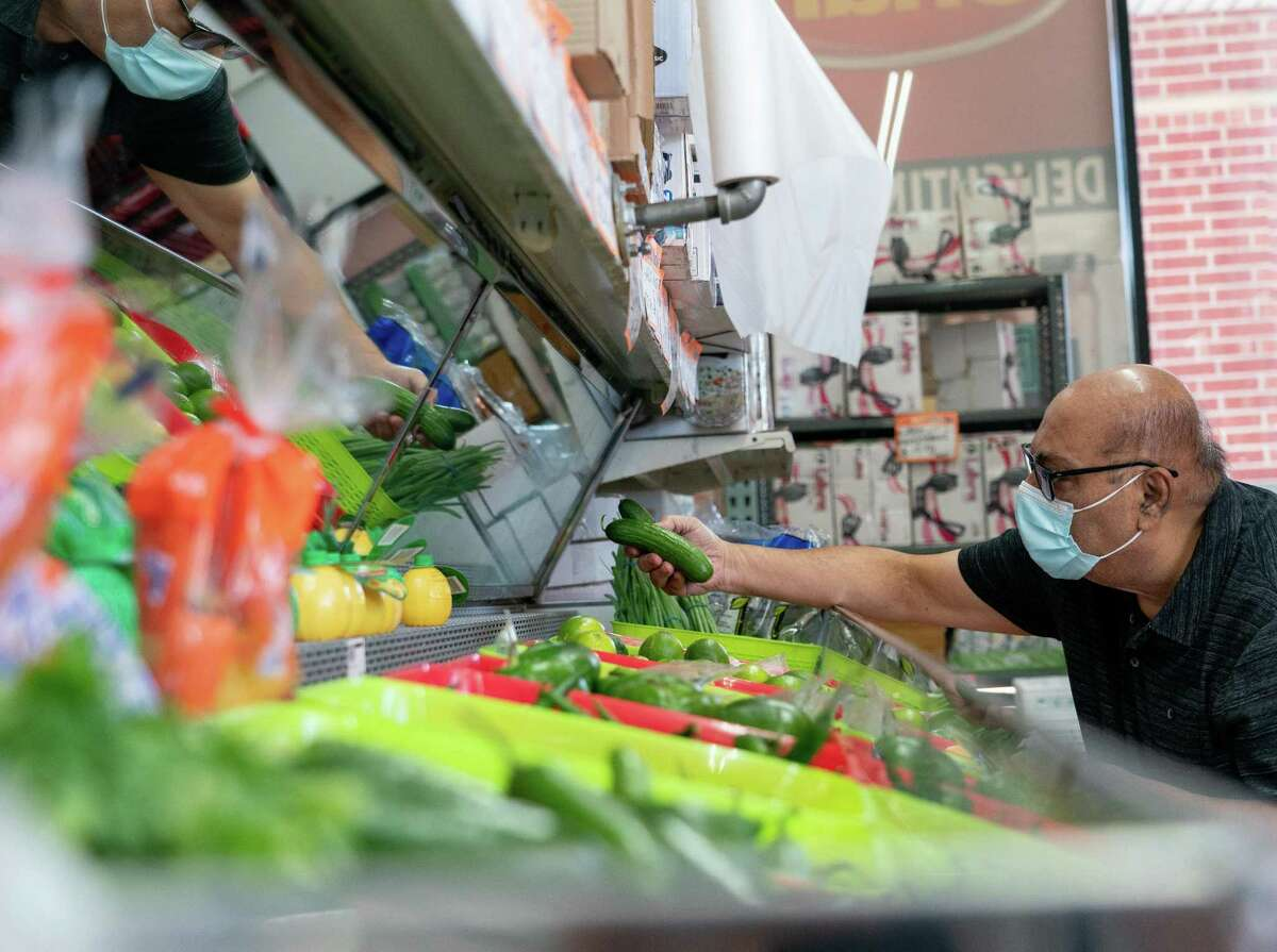 Alaudin Chagany, 71, shops for produce inside Asian Market on Thursday, Sept. 23, 2021, in Sugar Land. The Asian American population in the Houston-area suburbs is growing faster than any other segment of the population, according to data released last month by the U.S. Census Bureau.