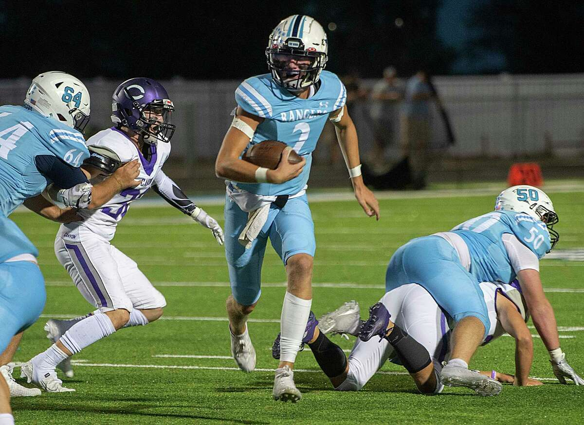 Greenwood's Ty Flowers picks his way through the Canyon defensive line on his way to a touchdown 09/24/2021 at J.M. King Memorial Stadium. Tim Fischer/Reporter-Telegram
