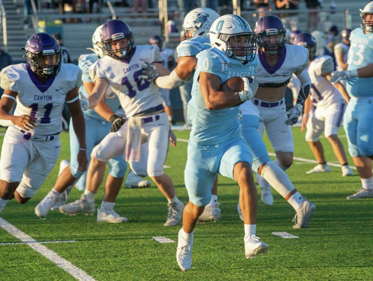 Greenwood's Aaron Fikes looks for more yards after getting around the Canyon defensive line 09/24/2021 at J.M. King Memorial Stadium. Tim Fischer/Reporter-Telegram