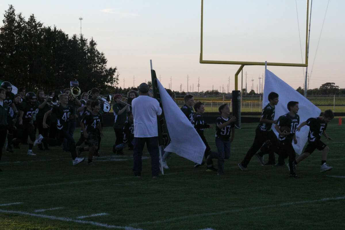 The Youth Lakers come out of the tunnel, introducing the Varsity team onto the field.