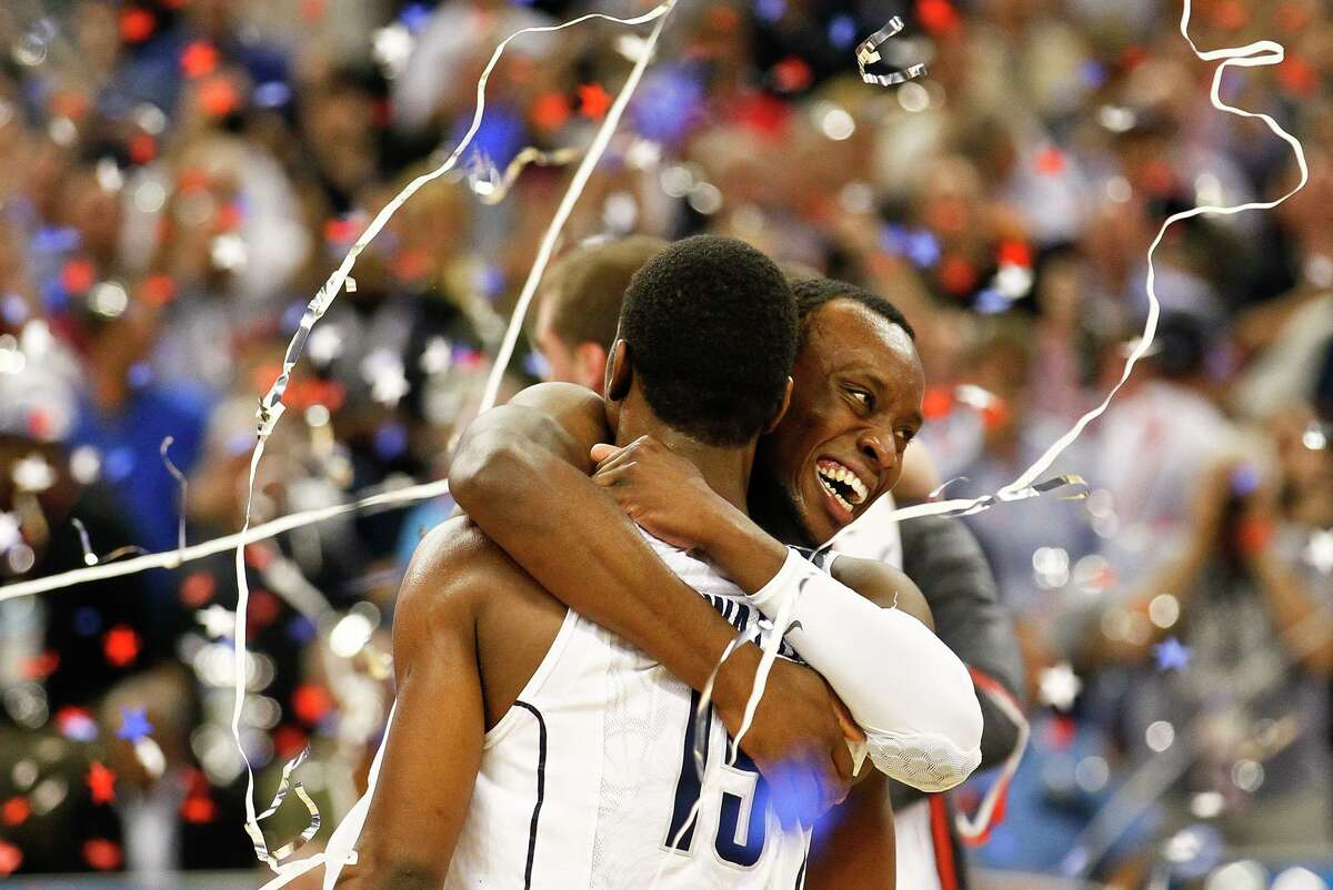 UConn players Donnell Beverly (2), facing, and Kemba Walker (15) celebrate after their victory over Butler in the 2011 NCAA national championship game in Houston.