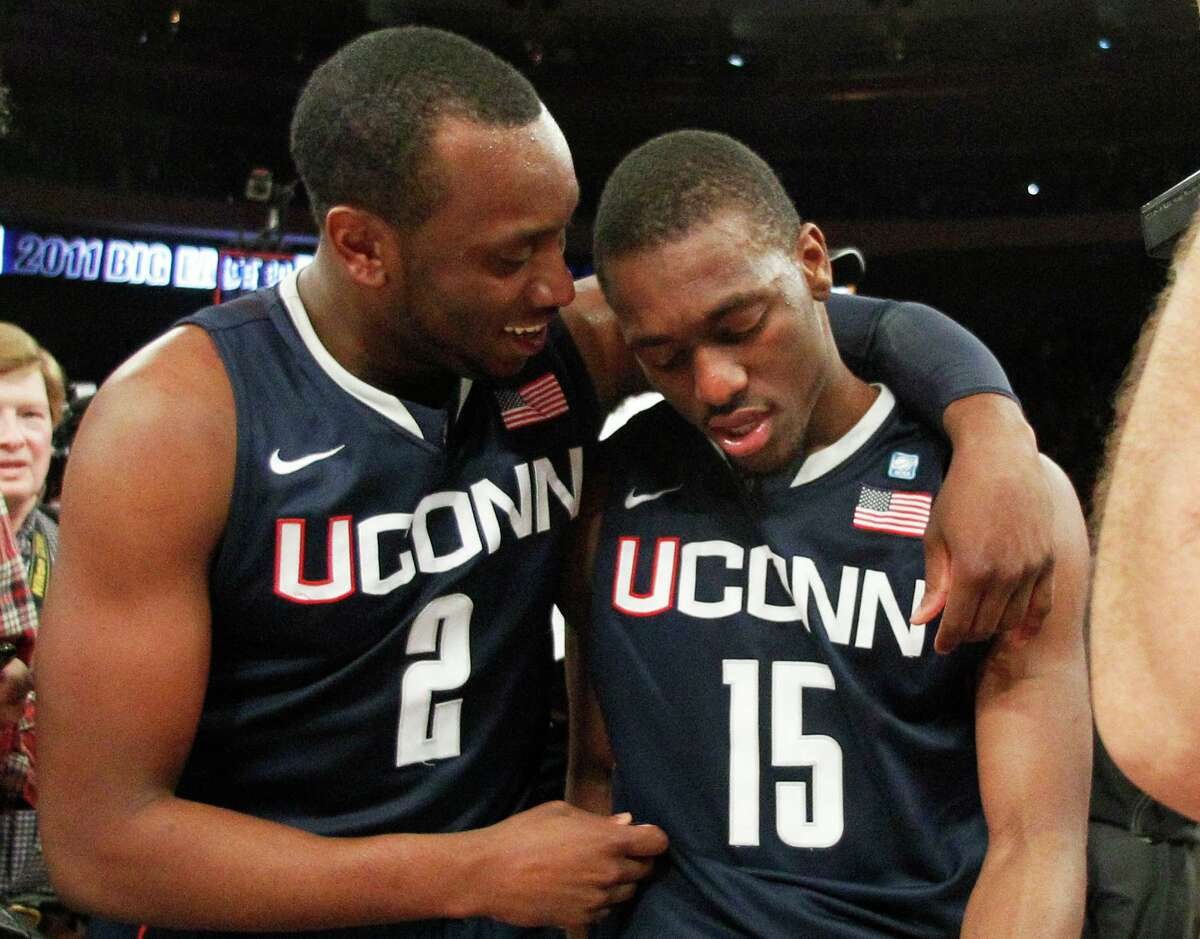 UConn's Donnell Beverly (2) celebrates with teammate Kemba Walker after their victory over Louisville in the Big East Tournament championship game in 2011.