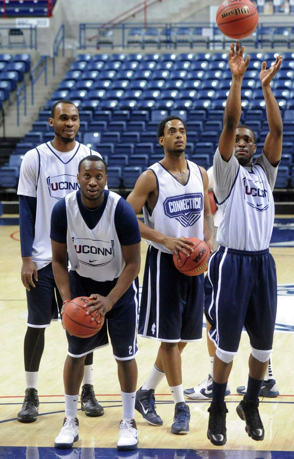 UConn players, from left, Charles Okwandu, Donnell Beverly, Jamal Coombs-McDaniel and Kemba Walker during a 2011 practice at Gampel Pavilion.