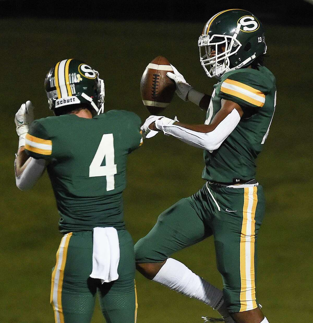 Stratford wide receiver Triston Williams, right, celebrates his touchdown with Luke Rives during the second half of a high school football game against Cy-Fair, Friday, Sept. 24, 2021, in Houston.