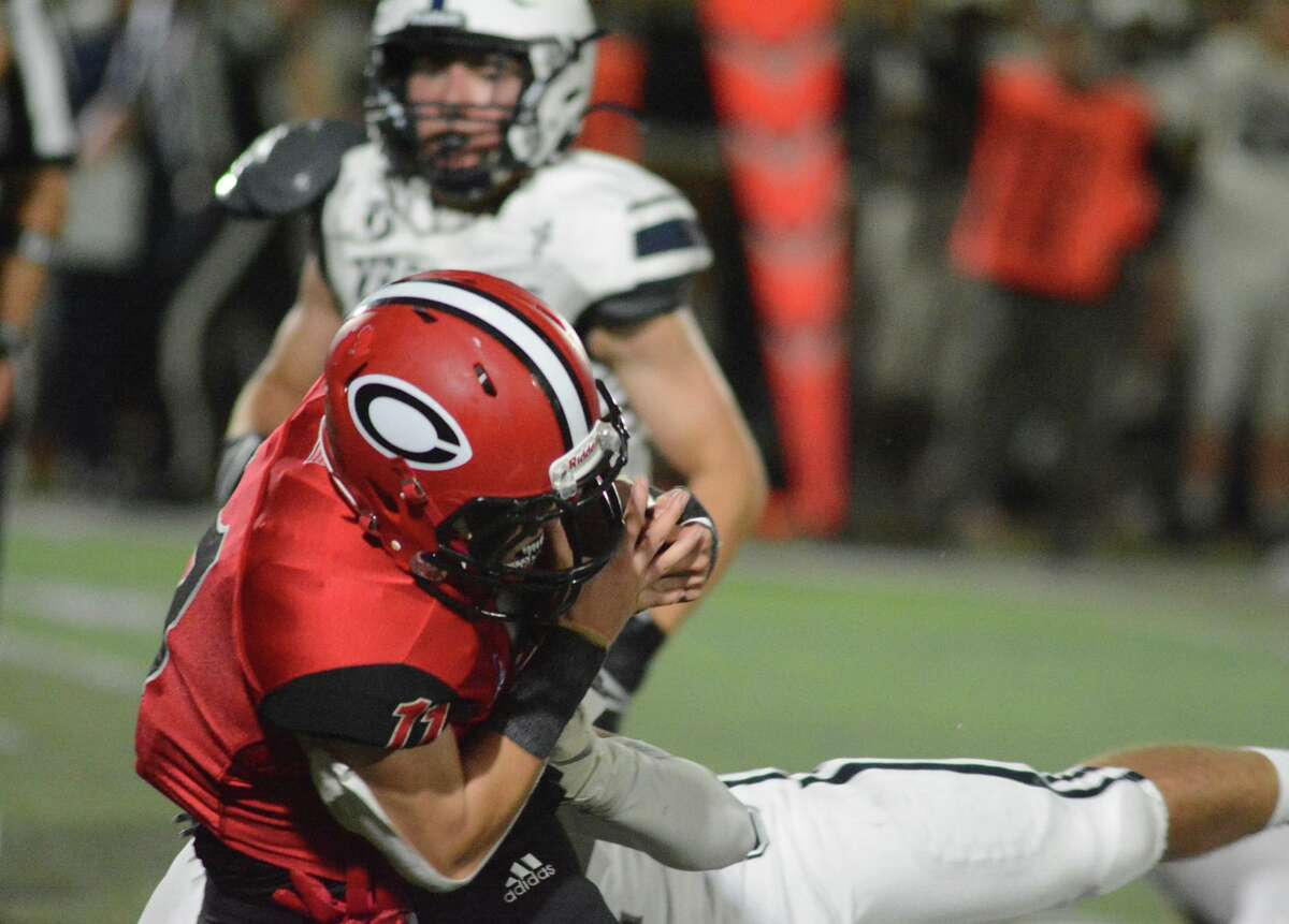 Cheshire's Mike Simeone carries the ball for a gain against Staples on Friday.