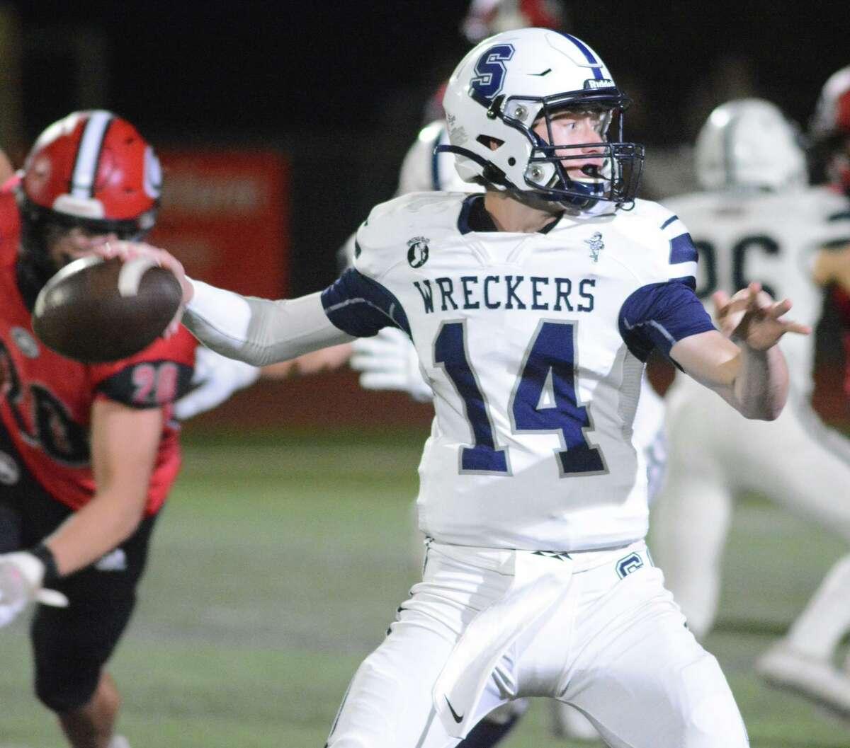 Staples quarterback Ryan Thompson throws the ball against Cheshire on Friday.