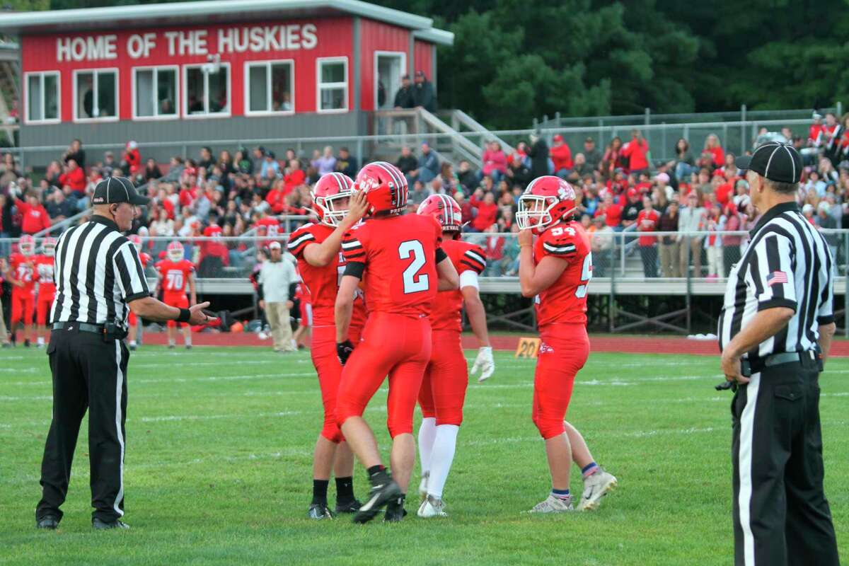 Benzie Central senior running back Nate Childers celebrates with his teammates following a first half touchdown against Elk Rapids. (McLain Moberg/News Advocate)