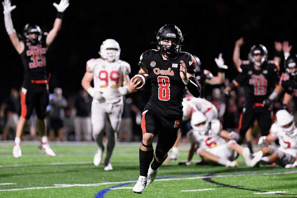 Shelton High's Shane Santiago hits the hole for a touchdown against Greenwich High Friday, September 21, 2021