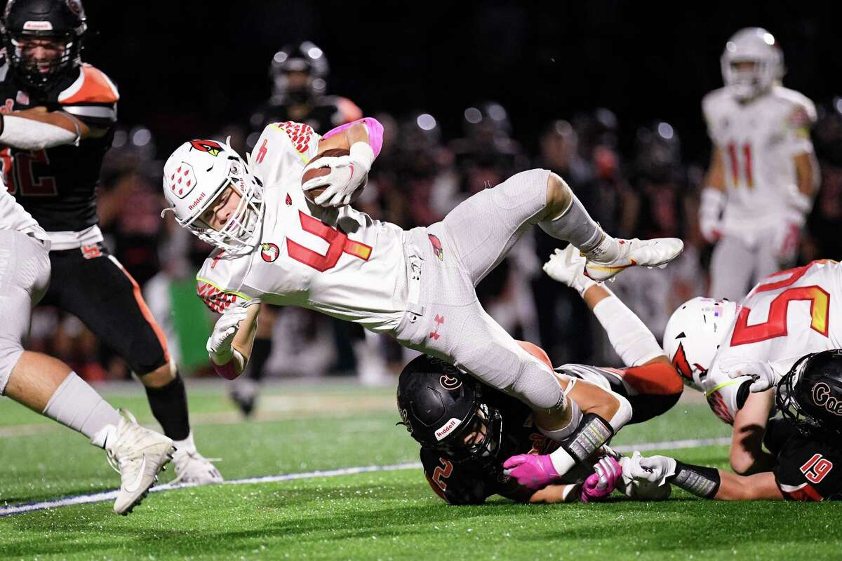 Greenwich High's James Babb fights for yardage against Shelton high Friday night at Finn Stadium.