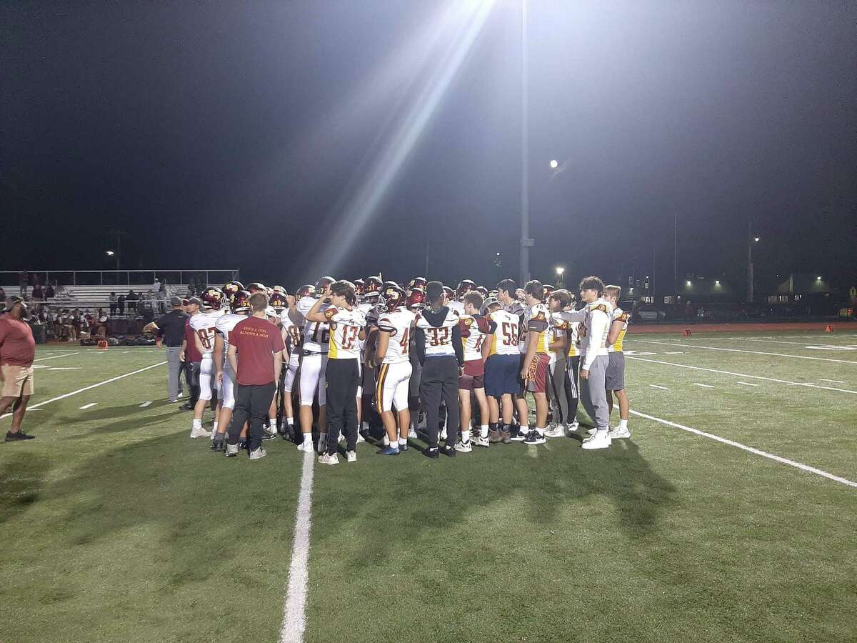 Members of the St. Joseph football team celebrate after defeating Windsor 45-22 Friday night.