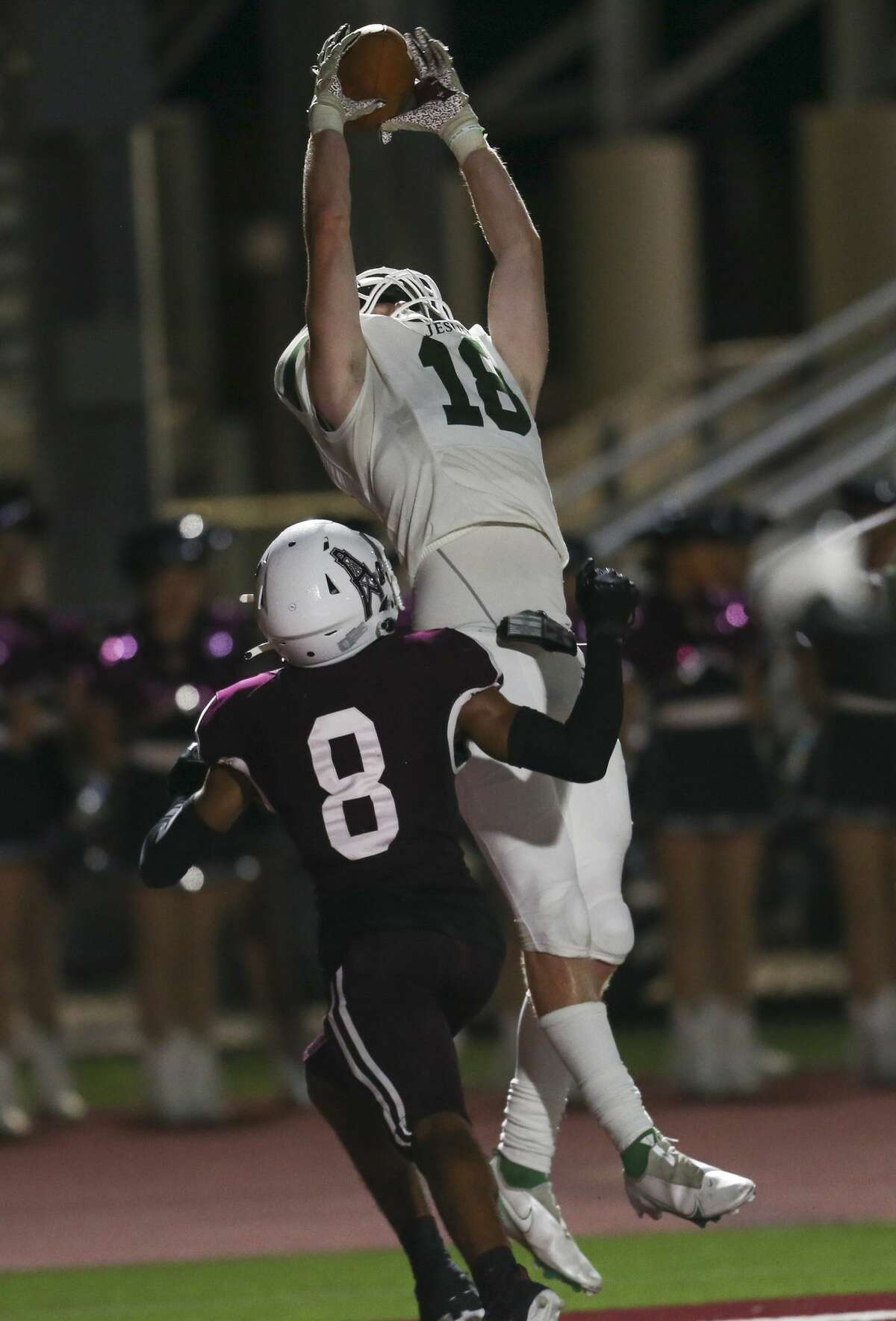 Strake Jesuit Fighting Crusader tight end Thomas Jewett #18 catches a 14 yard touchdown against Pearland Oilers defensive back Deveon Moses #8 in a high school football game on September 24, 2021 at The Rig in Pearland, TX.