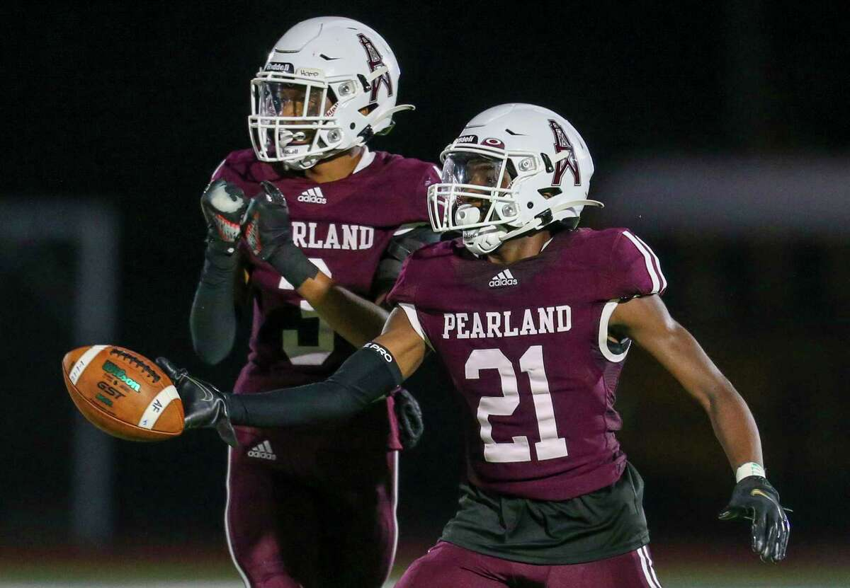 Pearland cornerback Torik Aigbedion (21) reacts after intercepting the ball against Strake Jesuit in a District 23-6A high school football game Friday in Pearland.
