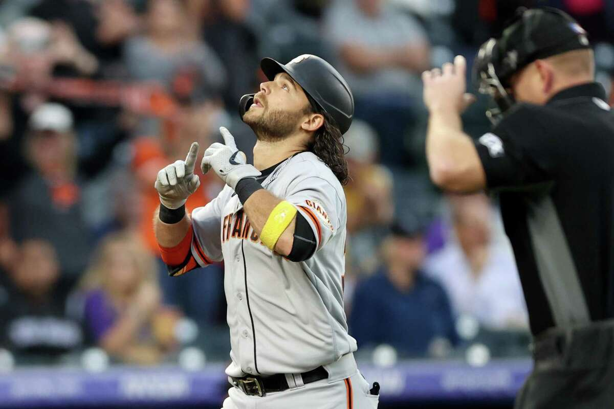 DENVER, COLORADO - SEPTEMBER 24: Brandon Crawford #35 of the San Francisco Giants gestures as he circles the bases after hitting a solo home run against the Colorado Rockies in the second inning at Coors Field on September 24, 2021 in Denver, Colorado. (Photo by Matthew Stockman/Getty Images)