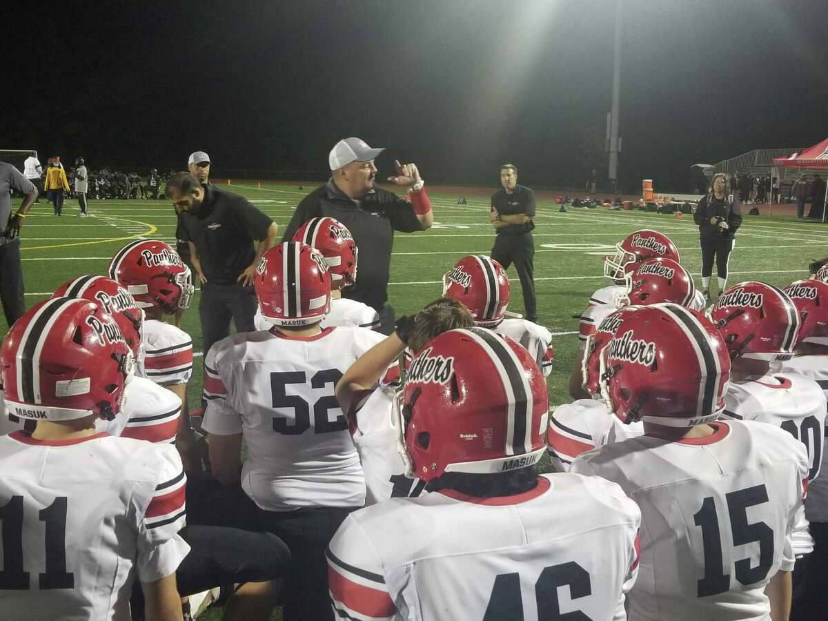 Masuk coach Steve Christy speaks to his players following the Panthers' 53-14 win over Hillhouse at Bowen Fiield on Sept. 24, 2021.