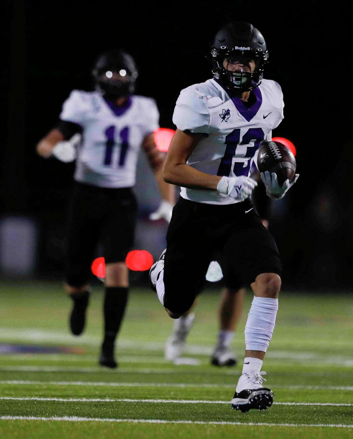 Fulshear wide receiver Jan Medica (13) runs for a 52-yard touchdown during the first quarter of a high school football game, Friday, Sept. 24, 2021, in Montgomery.