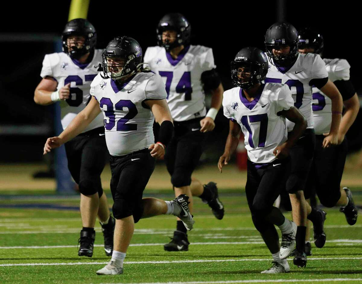 Fulshear running back Seth Smith (32) reacts after scoring a 3-yard touchdown during the second quarter of a high school football game, Friday, Sept. 24, 2021, in Montgomery.