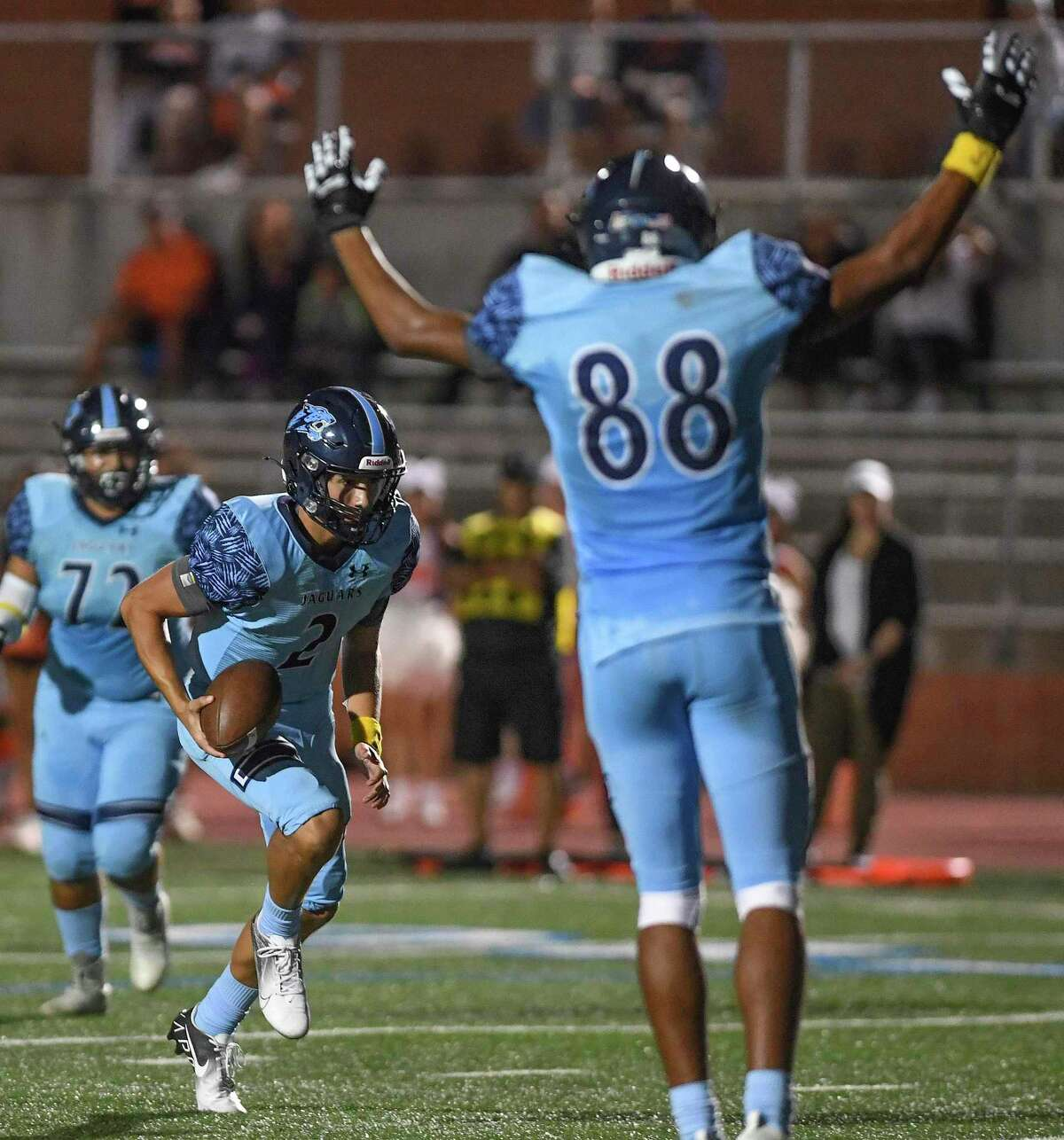 Johnson's Canaan Fairley (88) celebrates as quarterback Cruz Kirwan scores a touchdown during Friday's game against Brandeis. The game pitted a pair of undefeated District 28-6A teams.