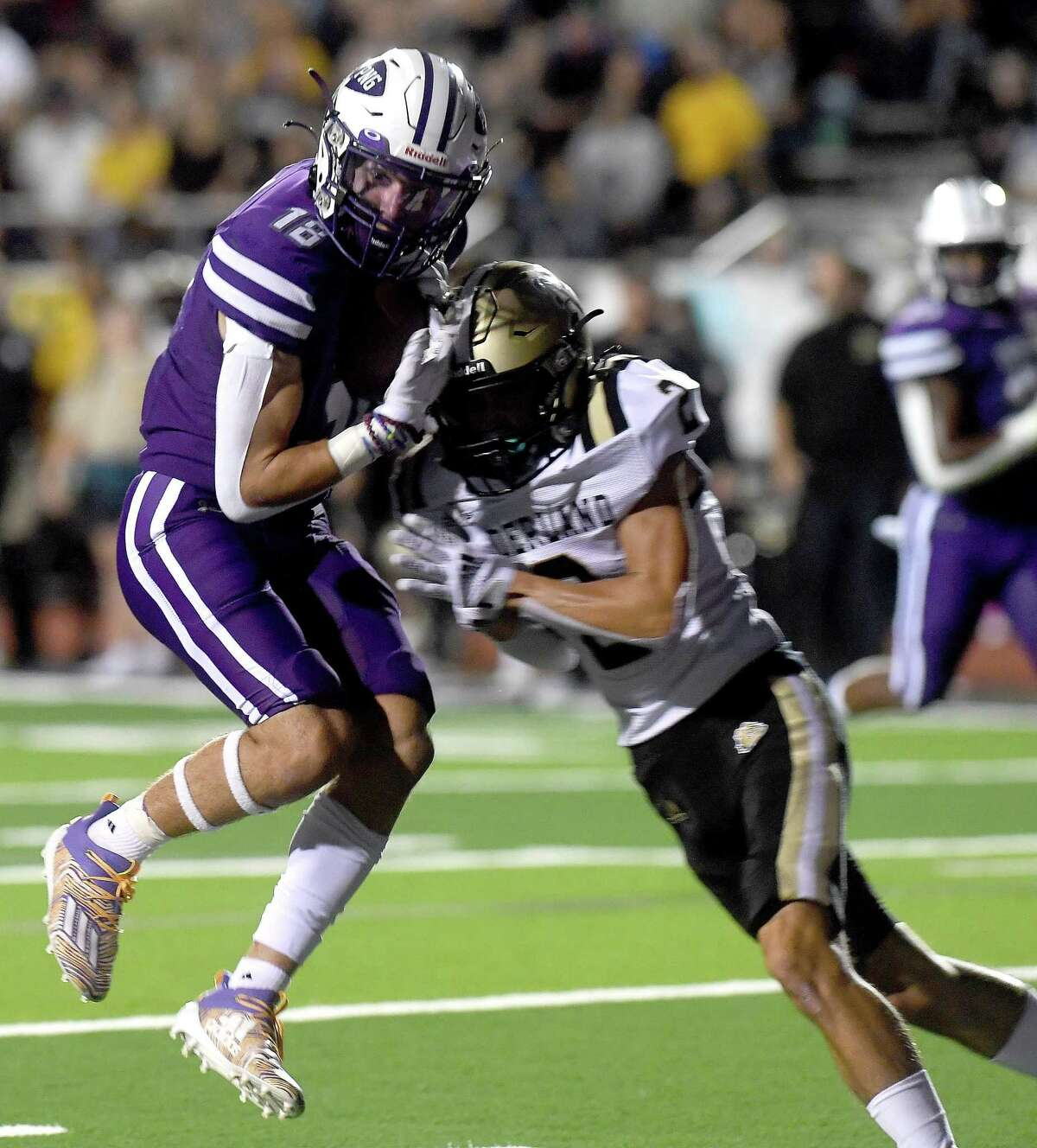 Port Neches-Groves' Chance Prosperie leaps into the end zone as Nederland's Slade Stoker closes in during Friday's Mid-County match-up at PNG. Photo made Friday, September 24, 2021 Kim Brent/The Enterprise