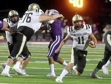 Port Neches-Groves' defense is held off as Nederland's Luke Broussard runs the ball during Friday's Mid-County match-up at PNG. Photo made Friday, September 24, 2021 Kim Brent/The Enterprise