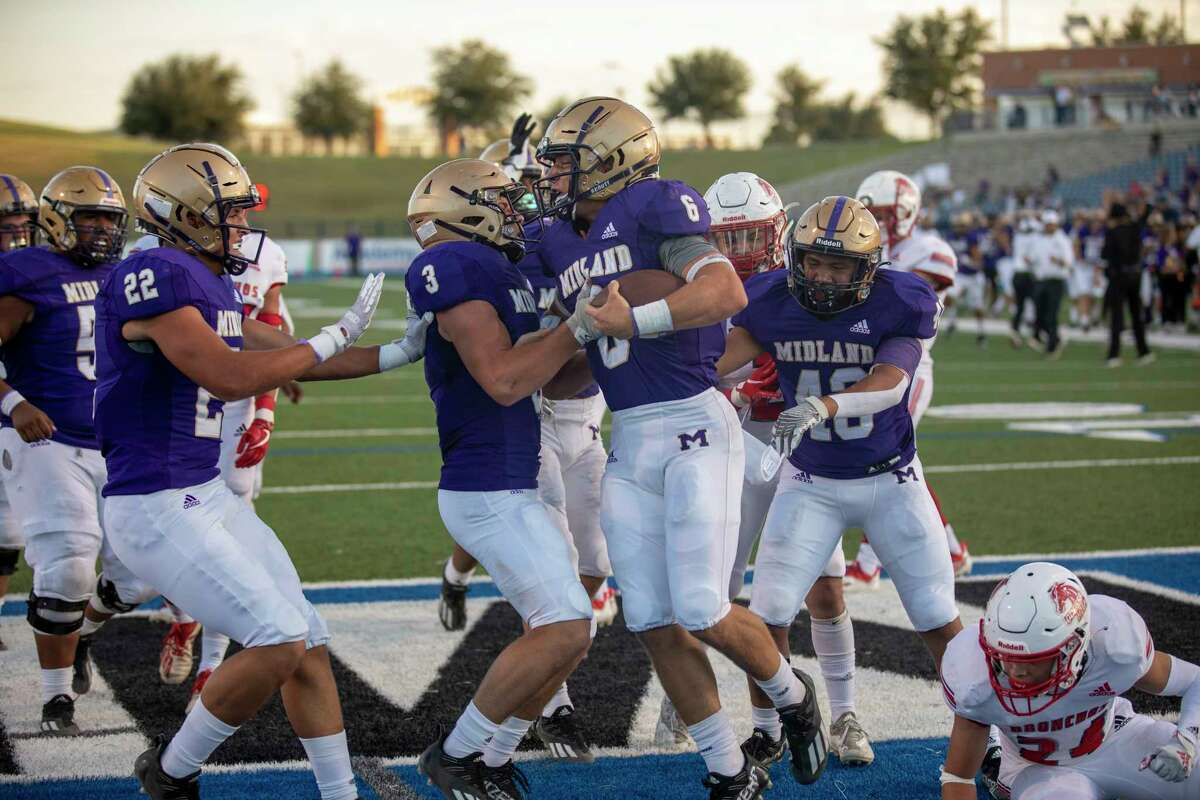 Midland High's Landry Walls (6) celebrate a touchdown with his teammates Friday, Sept. 24, 2021 at Grande Communications Stadium. Jacy Lewis/Reporter-Telegram