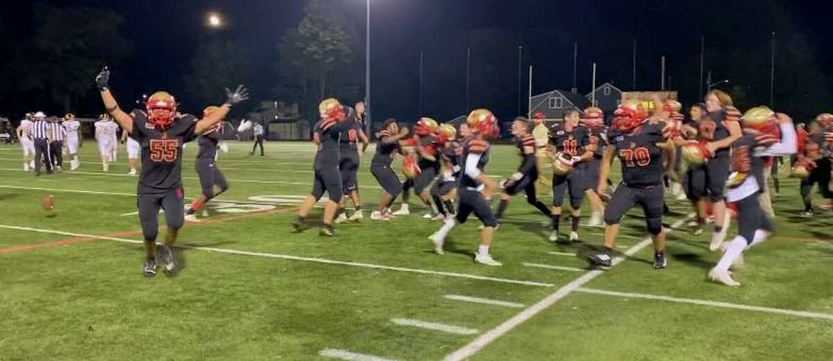 Stratford celebrates after winning its first football game in over two years. The Red Devils defeated Jonathan Law, 34-27, Friday night at Penders Field.