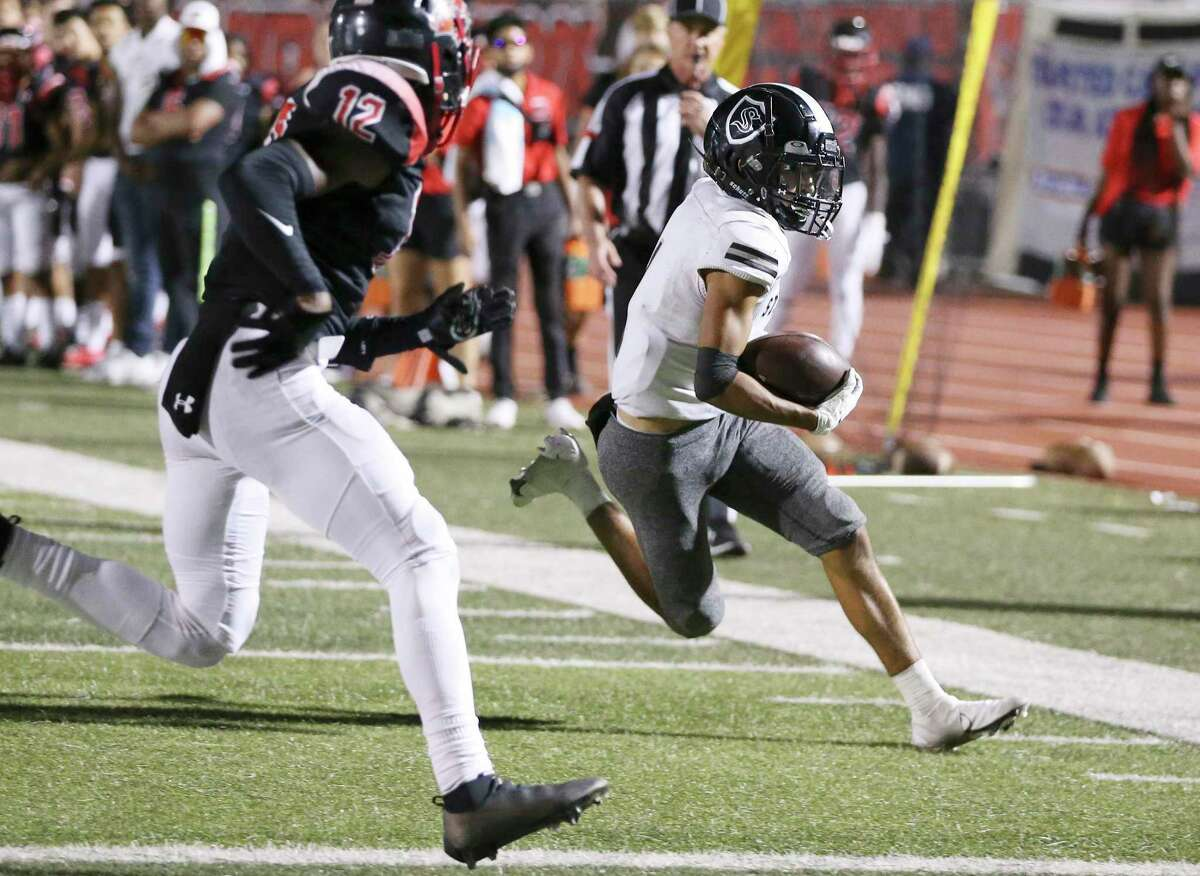 Steele's Joe Perez (right) runs toward the end zone against Wagner's Brendon Martin (12) to score a touchdown in the second of their football game at Rutledge Stadium on Friday, Sept. 24, 2021.