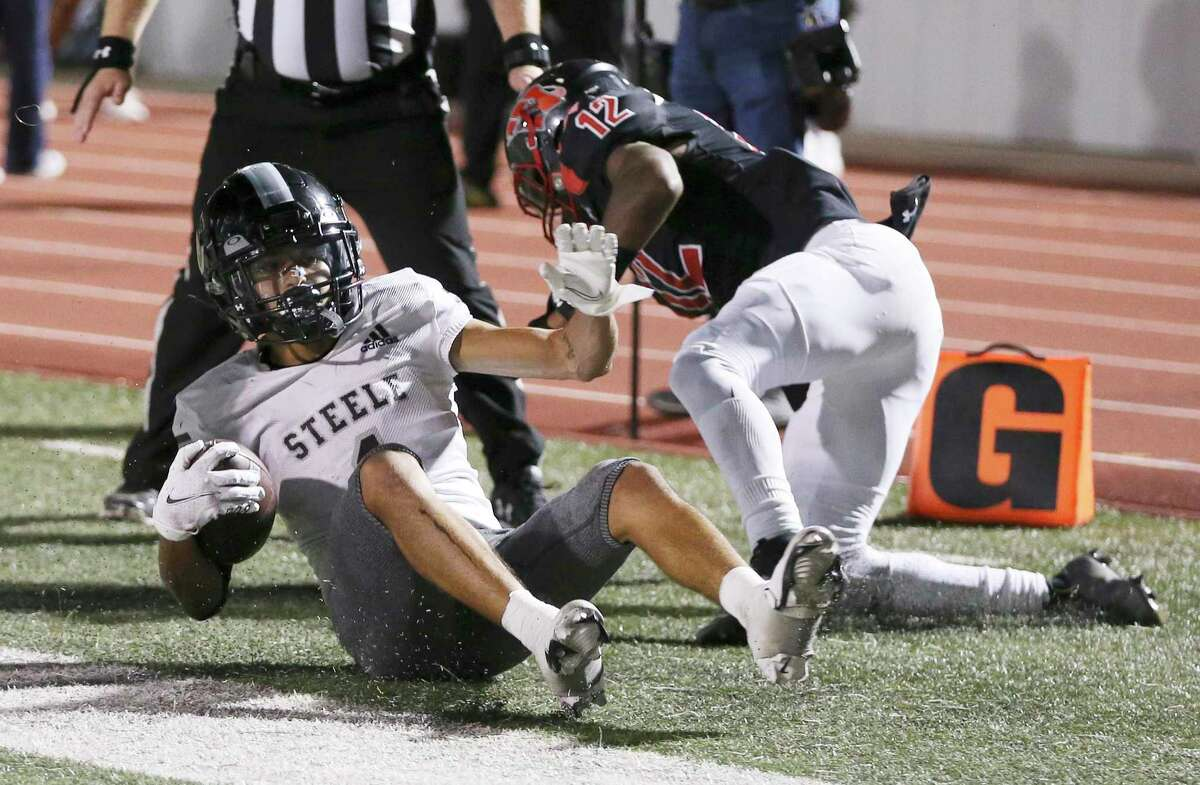 Steele's Joe Perez (left) dives in for a score against Wagner's Brendon Martin (12) in the second of their football game at Rutledge Stadium on Friday, Sept. 24, 2021.