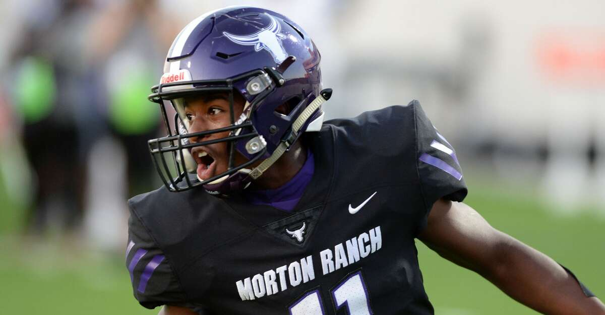 Santana Scott (11) of Morton Ranch reacts after scoring a touchdown during the first half of a non-conference football game between the Paetow Panthers and the Morton Ranch Mavericks on Friday, October 2, 2020 at Legacy Stadium, Katy, TX.