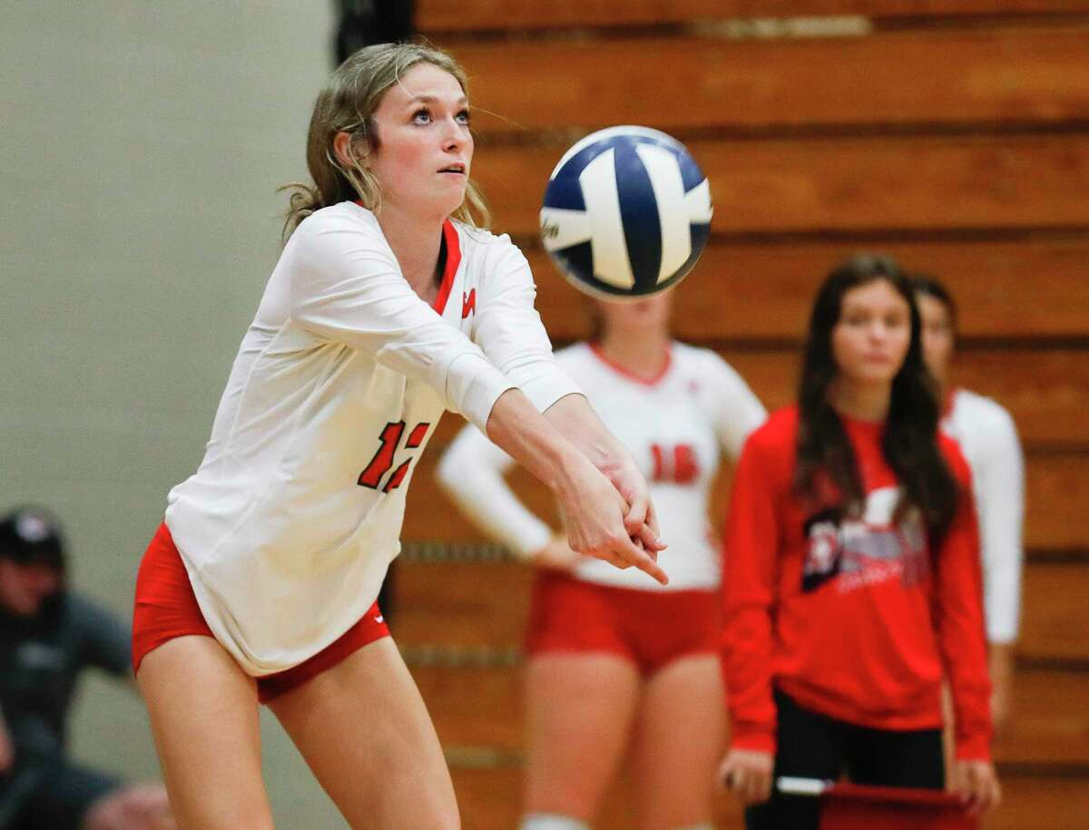 The Woodlands' Molly Tuozzo (12), shown here earlier this season, had a double-double of 29 assists and 15 digs Friday night against Oak Ridge.