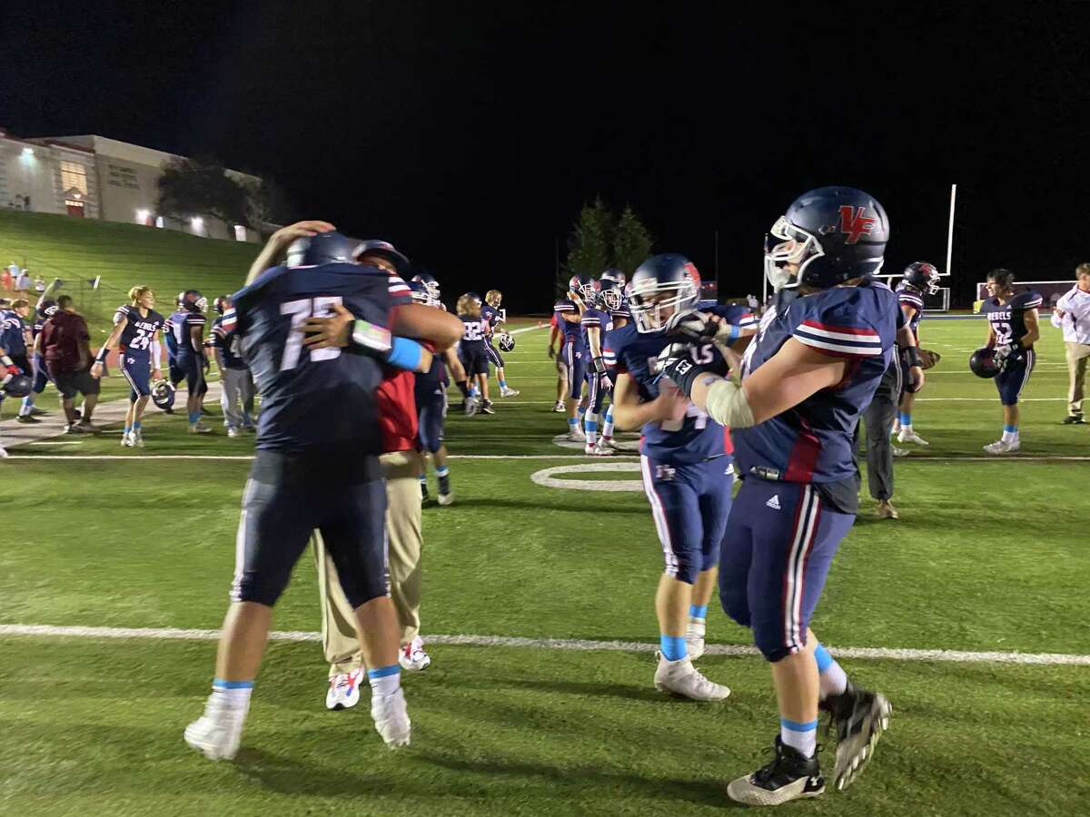 New Fairfield celebrates its 14-13 win over Sheehan Friday night.