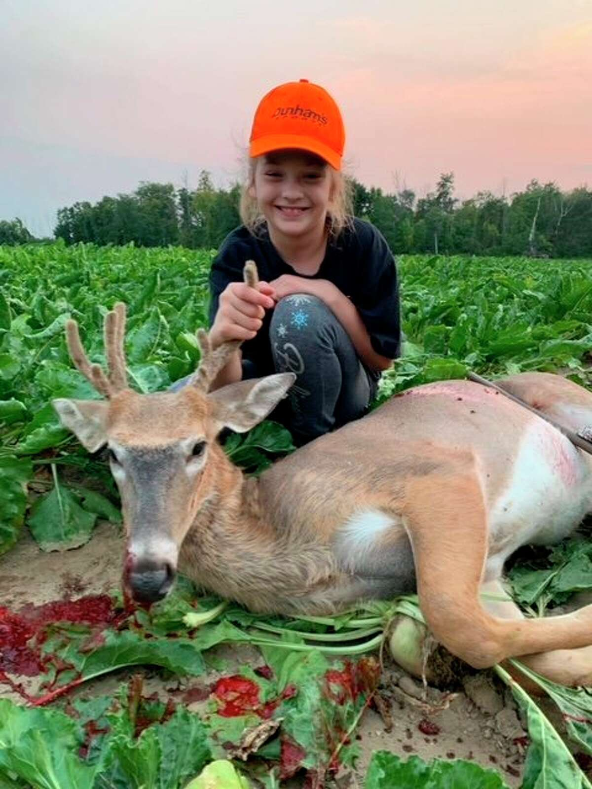 9-year-old Kailani Martin poses with an eight point.