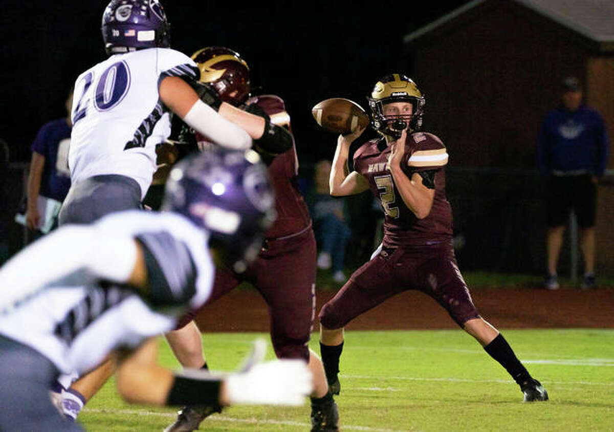 East Alton-Wood River quarterback Chase Keshnar (2) drops back for a pass while under pressure from Breese Central Friday night.