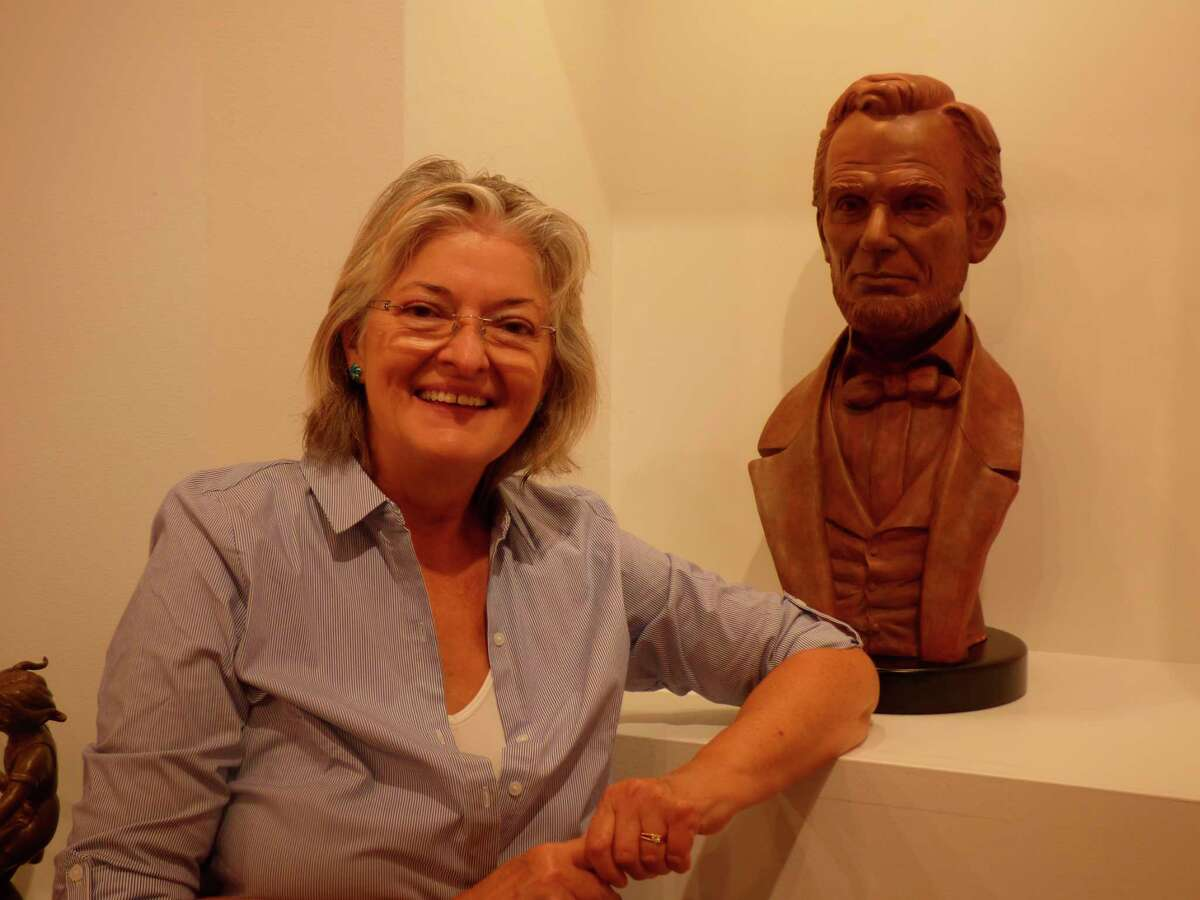 ArtistBernadette Zachara-Marcosposeswith a bust she made of Abraham Lincoln. An exhibit of her work is currently on display at the Ramsdell Regional Center for the Arts. Zachara-Marcos has been commissioned to create a statue of actor James Earl Jones and his mentor Donald Crouch by the Arts and Cultural Alliance of Manistee County. (Scott Fraley/News Advocate)