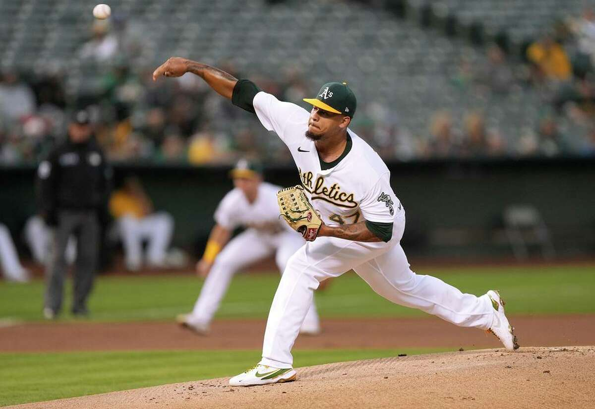 OAKLAND, CALIFORNIA - SEPTEMBER 24: Frankie Montas #47 of the Oakland Athletics pitches against the Houston Astros in the top of the first inning at RingCentral Coliseum on September 24, 2021 in Oakland, California. (Photo by Thearon W. Henderson/Getty Images)