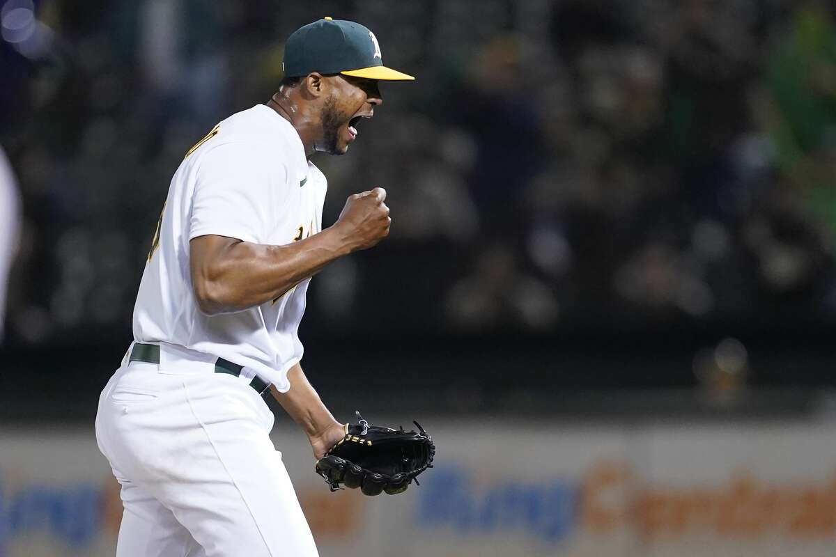 Oakland Athletics pitcher Domingo Acevedo celebrates after the Athletics defeated the Houston Astros in a baseball game in Oakland, Calif., Friday, Sept. 24, 2021. (AP Photo/Jeff Chiu)