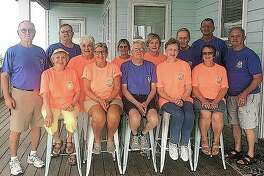 The Cors siblings reunited this month in Gulf Breeze, Florida. They are Joe (back row, from left), Tom, Carolyn, Judy, Marilyn, Ted, Ken and Bill. Their spouses are Ellen (front row, from left), Connie, Ken, Anne and Sandy.