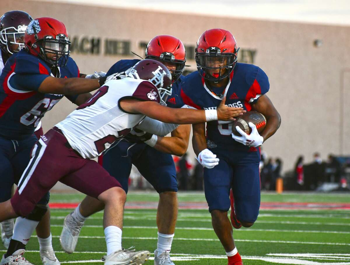 Plainview's Karomo Collins fights for yardage on a run during a non-district football game against Hereford on Friday in Greg Sherwood Memorial Bulldog Stadium.
