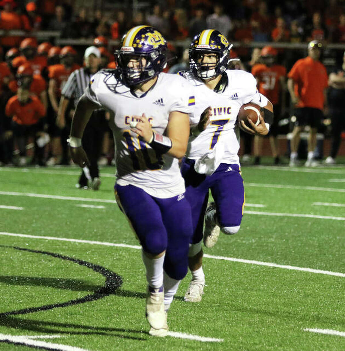 CM running back Nick Brousseau (10) leads the way for quarterback Bryer Arview's 6-yard run in OT on Friday night in Waterloo.