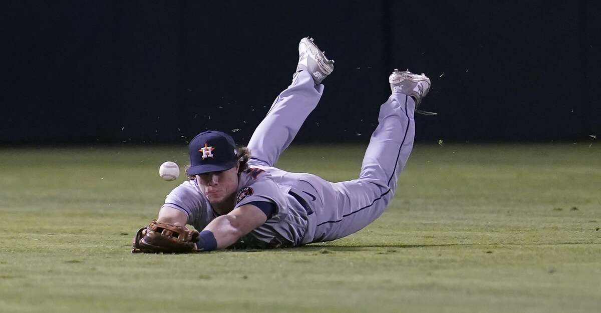 Houston Astros center fielder Jake Meyers cannot catch an RBI-single hit by Oakland Athletics' Starling Marte during the eighth inning of a baseball game in Oakland, Calif., Friday, Sept. 24, 2021. (AP Photo/Jeff Chiu)