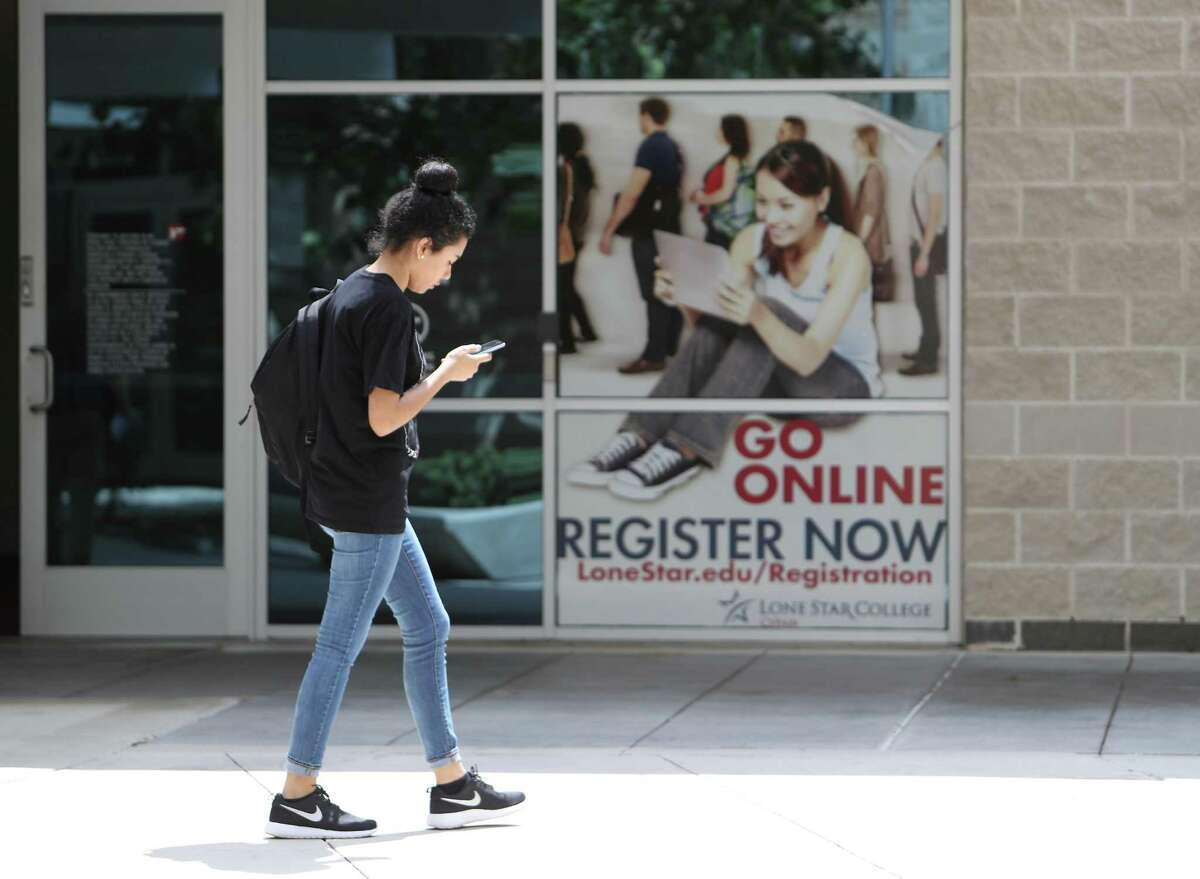 A Lone Star College-CyFair student walks on the campus Tuesday, May 16, 2017, in Cypress. Lone Star is one of the community colleges through a new legislation that would be allowed to offer bachelor's degrees. ( Steve Gonzales / Houston Chronicle )