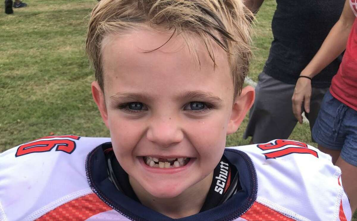Colin Bisel of Cypress (photos attached) is all smiles as the Houston Texans official Kick-Off Kid for the team's home game against the Carolina Panthers