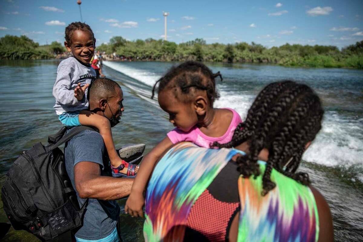 Migrants cross through the Rio Grande in Ciudad Acuna, Mexico, on Sept. 16. Del Rio has seen an influx of migrants mostly from Haiti since early 2021.