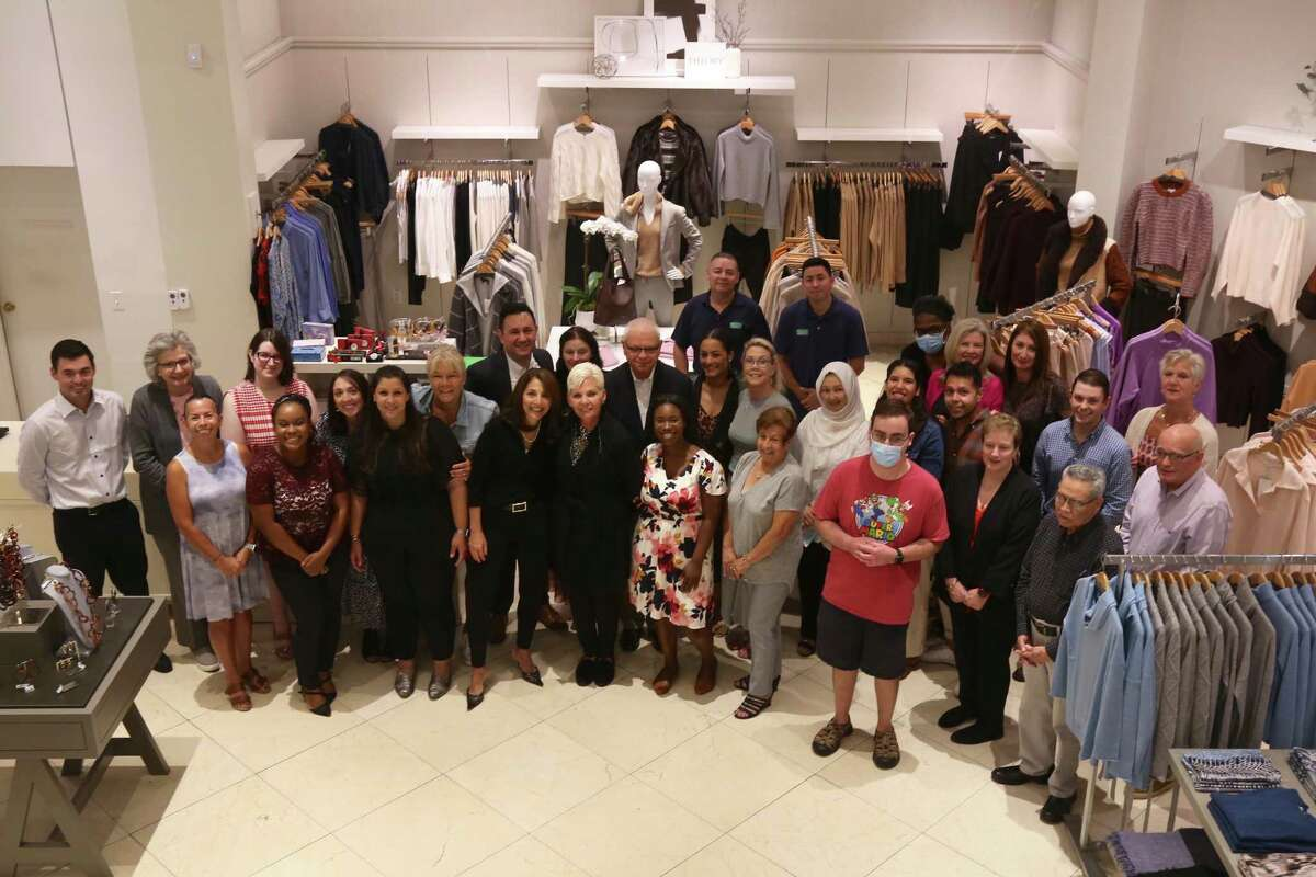 The staff of the Darien Sport Shop celebrate the store's 75th anniversary on Sept. 22, 2021.
