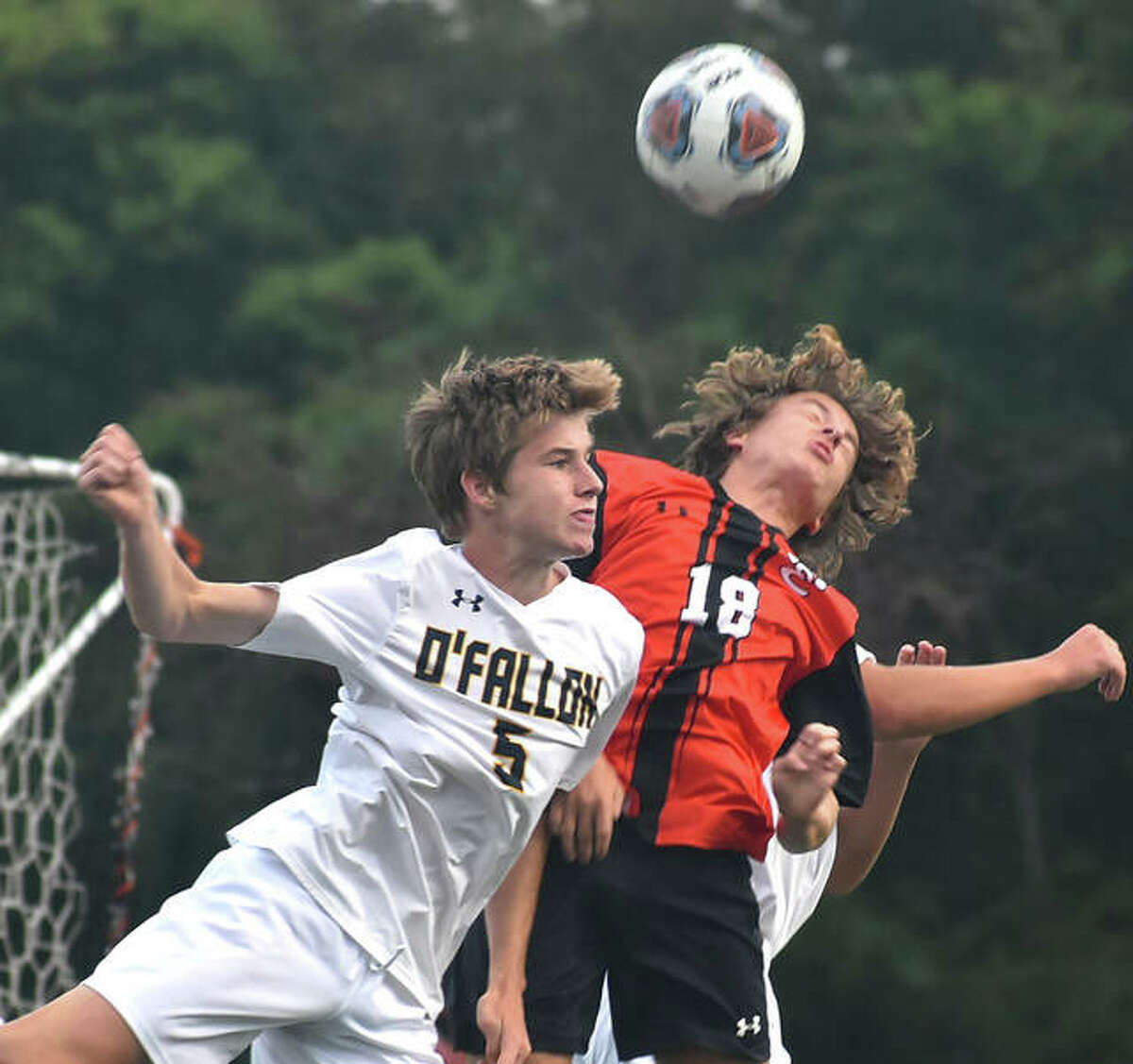 Edwardsville's Troy Chenault, right, challenges O'Fallon's Tyler Howe for a ball in the first half of Friday's Southwestern Conference game in Edwardsville.