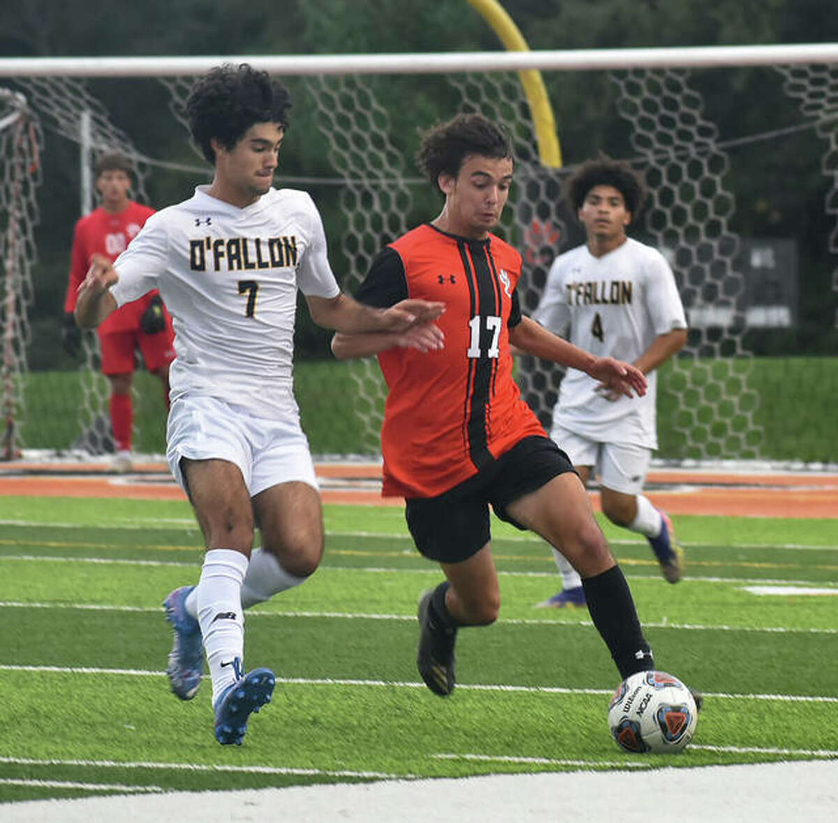 Edwardsville's Wyatt Erber, right, keeps the ball away from O'Fallon's Andre Robertson in the first half.